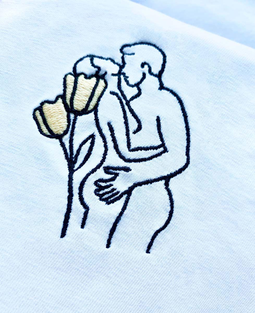 Tablier à poche Couple nu (brodé)